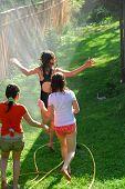 Girls Run Sprinkler