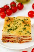 Italian lasagna with meat and tomatoes.