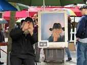 Paris, France - May 31, 2006: Public Painter On Montmartre Screening His Face And Instead Showing Se