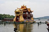 Large Dragon Boats Packed With Tourists Cruise The Waters Of The Famous West Lake, Hangzhou, China