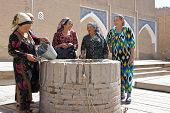Old women around a well, Khiva, Uzbekistan
