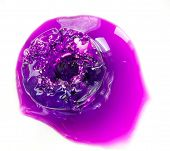 picture of potassium  - Cocktail ice colored with potassium permanganate on a white background.