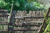 Old Wooden Lopsided Fence. Time Effect. Rural Scene