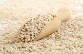 Hulled Pearl Barley And A Wooden Shovel