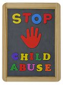 Stop child abuse written on school slate