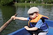 Boy Rowing Boat