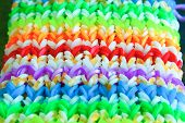 image of loom  - Big colorful rubber rainbow band made on loom - JPG