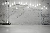 picture of wall-stone  - Old damaged brick wall with light bulbs - JPG