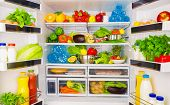 foto of orange-juice  - Open fridge full of fresh fruits and vegetables - JPG
