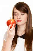 Diet. Girl Smelling Apple Seasonal Fruit.