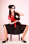 Retro Music. Pinup Girl With Vinyl Record