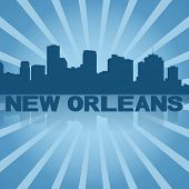 New Orleans skyline reflected with blue sunburst illustration