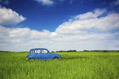 image of 70-year-old  - Beautiful old vintage car on a green meadow - JPG