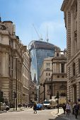 LONDON, UK - JUNE 30, 2014  Busy city of London street, leading to the Bank of England