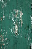 Old green textured board with cracks