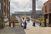 LONDON, UK - JUNE 30, 2014  Millennium bridge view on Tate modern gallery from St  Paul cathedral