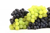Bunch of white and black grapes.