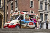 LONDON, UK - JULY 03, 2014  ice cream van and young costumers on London s street