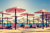 Thatched umbrellas and beach chairs on the beach. Budva, Montenegro, Balkans, Europe. Beauty world.