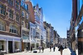 LONDON, UK - JULY 03, 2014  Bond street boutiques, street of famous small fashion businesses