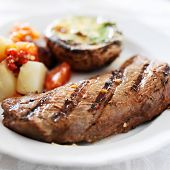 picture of braai  - grilled steak with potatoes and stuffed mushroom - JPG