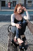 Young Relaxing Woman On Bench Outdoors