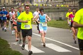 KRAKOW, POLAND - MAR 23, 2014: Unidentified participants during the annual Krakow international Marathon. Krakow Marathon conducted since 2002 under the slogan: With history in the background.
