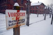 stock photo of auschwitz  - Warning sign at the nazi concentration camp Auschwitz - JPG