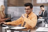 Businessman sitting at desk in office, busy by working.