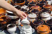 Handmade Clay Pots And Woman Hand Hold Clay Lit