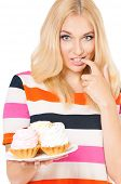 Portrait of beautiful young blond woman with cake, isolated on white background
