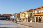 CUZCO, PERU, MAY 1, 2014 - Plaza de Armas,  characterized by covered walkways, colonial arcades and houses containing numerous shops, restaurants and travel agencies.