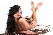 sexy woman lying with coffee beans