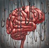 picture of hook  - Addiction and dependency concept as a human brain being lured and surrounded by fishing hooks as a risk symbol and metaphor for a drug addict or the danger of alcoholism gambling and drug abuse smoking as a mental health problem - JPG