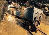 stock photo of minerals  - Underground mine tunnel mining industry with railway - JPG