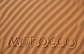 Word Morocco writen on sand in the dunes of Erg Chebbi in the Sahara Desert, Morocco.