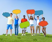 Group of People Holding Colorful Speech Bubbles Outdoors