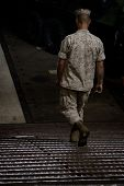 NEW YORK - MAY 22: A sailor walks down a metal ramp to the well deck of the amphibious dock landing