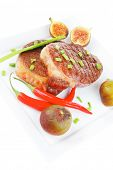savory : grilled juicy beef pork steak served with hot cayenne peppers green chives and sweet figs o