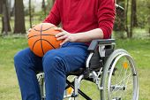 Disabled Holding A Basketball Ball