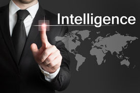 foto of incognito  - agent in black suit pressing button intelligence world map surveillance - JPG