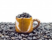 Coffee Beans In Ceramic Cup On Coffee Beans Background