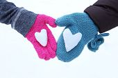 Snow Hearts held in two hands