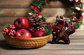 Christmas apples on wooden table
