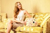 Charming young woman in a room with expensive classic interior. Interior. Furniture.