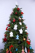 stock photo of christmas angel  - Knitted Christmas angels and other decorations on Christmas tree background - JPG