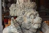 a stone statue in temple in bali