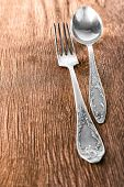 Spoon and fork on wooden background