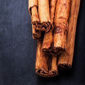 Bunch Of Cinnamon Sticks Close Up On Dark Background With Blank Copyspace For Your Text