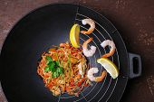 picture of chinese wok  - Chinese noodles with vegetables and seafood in wok - JPG
